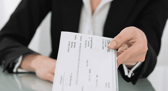 spousal support lawyer handing check