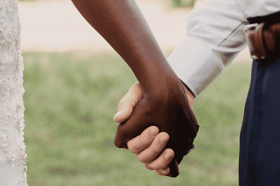 two people remarrying holding hands